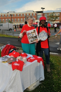 Committee members sell memorabilia at the 2012 fireworks.
